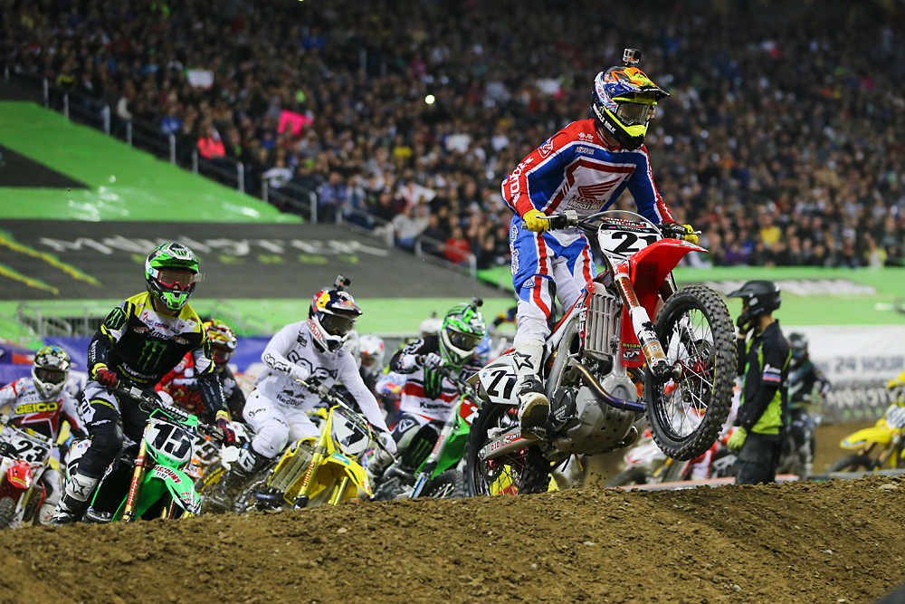 Cole Seely (Troy Lee Designs/Lucas Oil/Honda, on board Trey Canard's Team Honda Muscle Milk CRF450) grabbed the holeshot and led the first lap and most of the second before James Stewart muscled his way by.