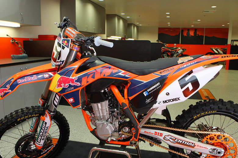 Here's Ryan Dungey's 2013 race bike, along with the 2013 Red Bull/KTM livery. These graphics were the first run of the new look, and we hear that they'll use graphics that are in-molded to the plastic for the race season. If you peek back along the wall, you notice that there are four bays for race bikes (and two for practice bikes), but only three race bikes currently on the team. Roger also mentioned that they expect their race bike to be close to the AMA minimum for the 450 class.