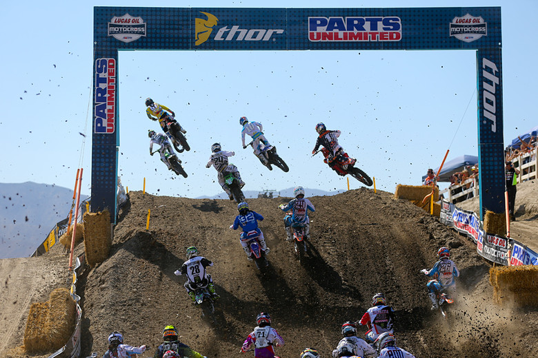Ryan Villopoto (Monster Energy Kawasaki) leading the pack over the hill after the start of moto two in the 450 class.
