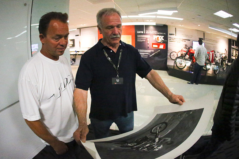 Marty Smith (left), and Bob Fox looking over some prints of Marty's days at Factory Honda. Bob also had quite a few snapshots from back in the day that his guests were poring over.