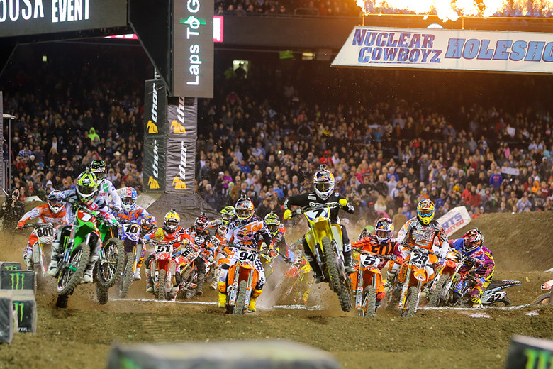 In the 450 main, Ryan Villopoto (Monster Energy Kawasaki) and James Stewart (Yoshimura Suzuki Factory Racing) were the first two to exit the first corner. But don't count out that guy lurking just over Villopoto's left shoulder.