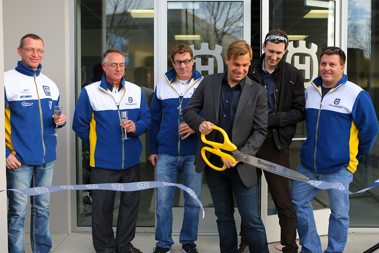 In front of a large group of dealers, there was a ceremonial ribbon-cutting with Mathias Kumpf, Robert Pierce, Jon-Erik Burleson, Hohn Hinz, Reinhold Zenz (President of Husqvarna Worldwide), and Brad Hagi.