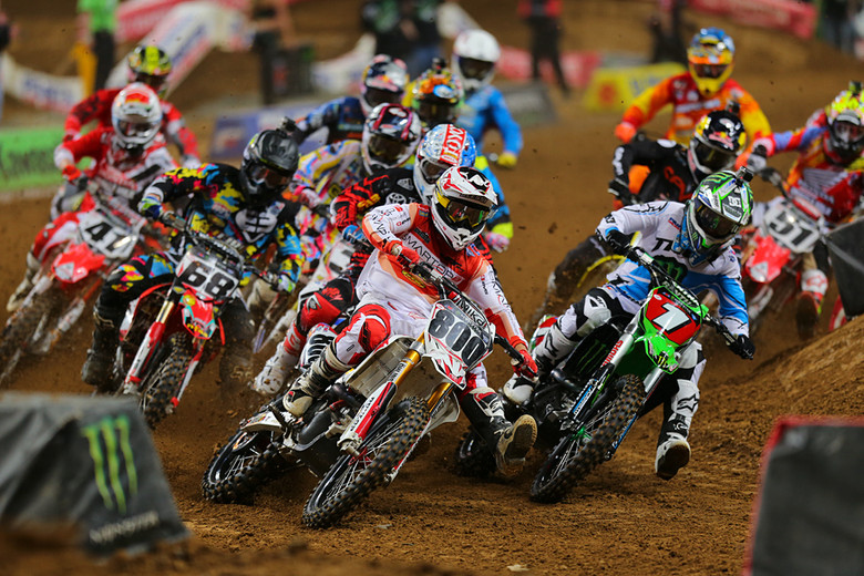 Mike Alessi (Smartop MotoConcepts Racing) grabbed the holeshot in the 450 main event, but Ryan Villopoto (Monster Energy Kawasaki) quickly took over the lead.