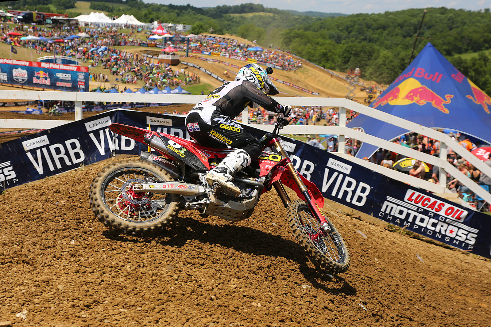 Jeremy Martin scored the holeshot in the first 250 moto, and led until just before halfway, when Zach Osborne got by.