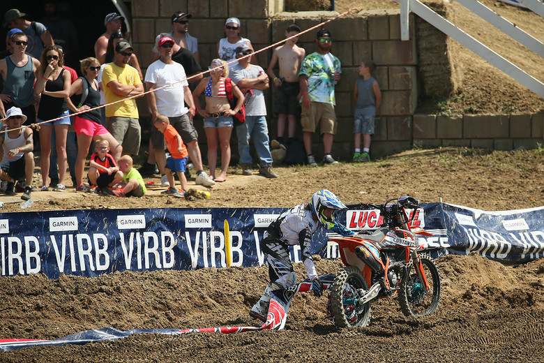 Eve Brodeur was doing well in moto one, but picked up a large string of repeater banners in her rear wheel.