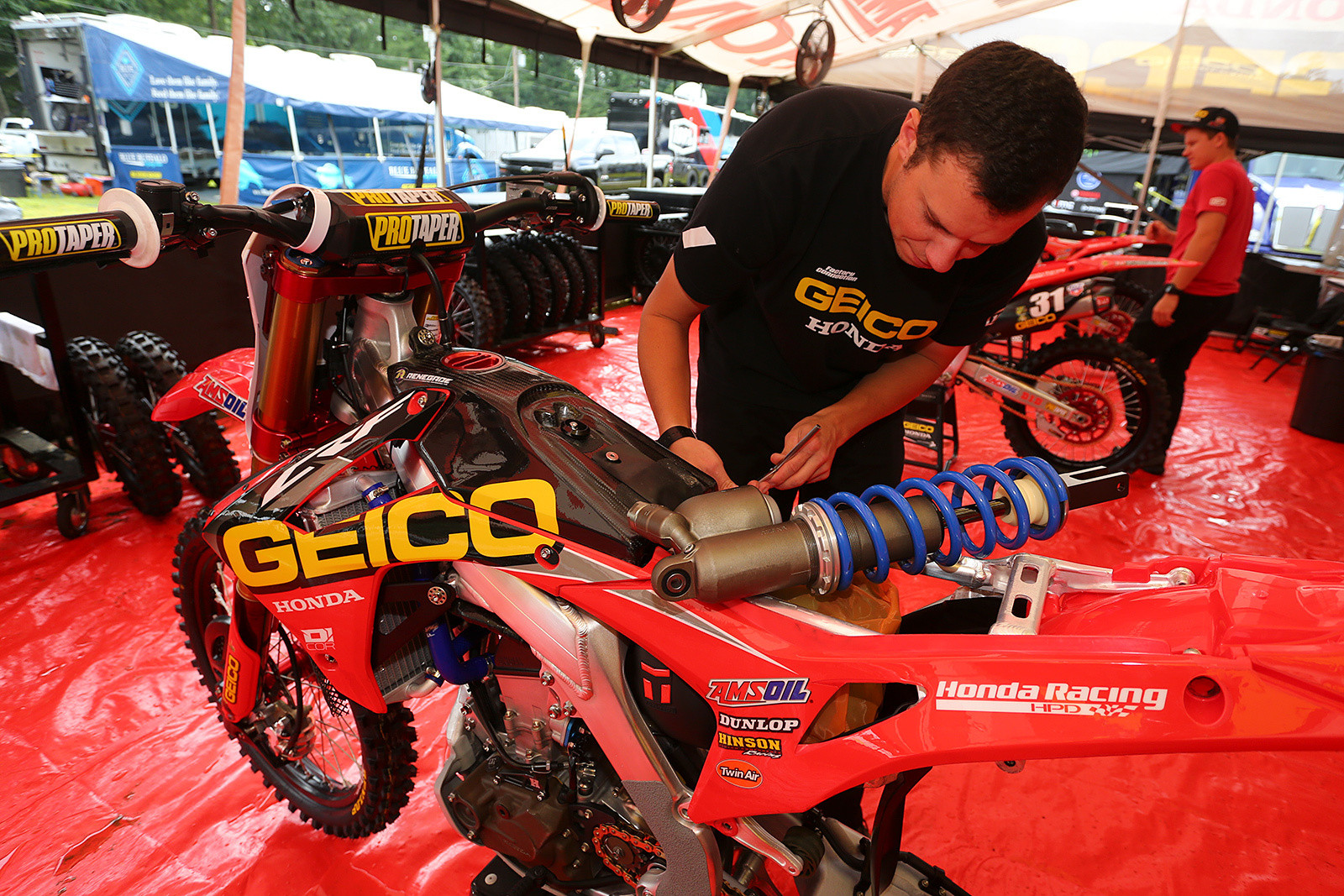 Pedro, getting ready to drop a fresh shock into Jeremy Martin's bike.