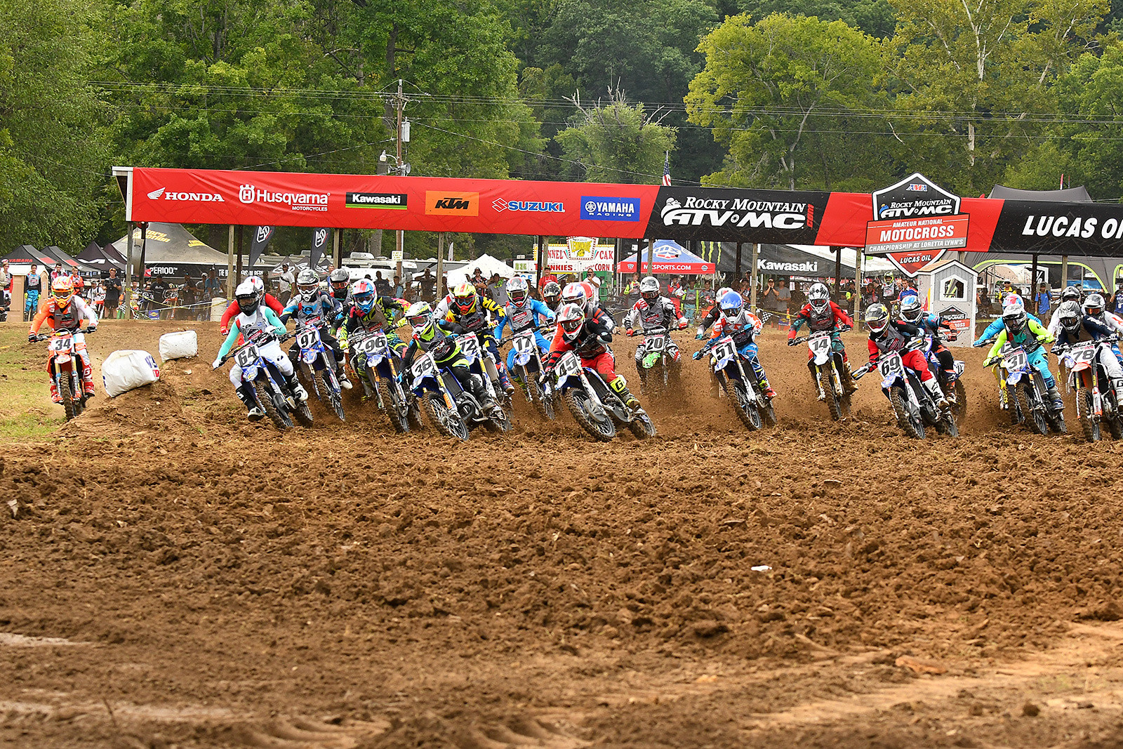 250 A class start with a rider pushed off to the inside on the loamy Loretta Lynn's start.