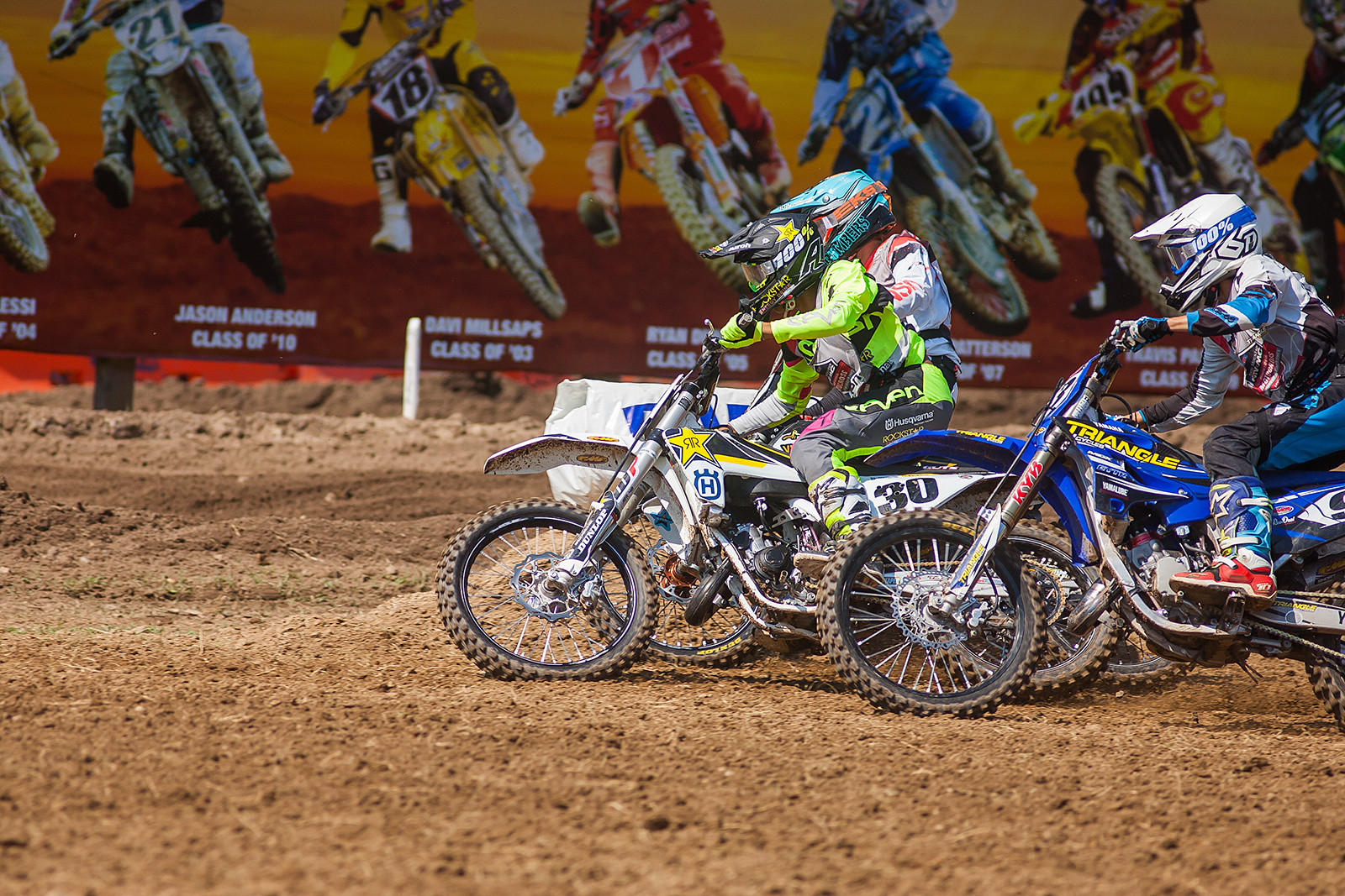 Husqvarna-supported Jalek Swoll rides past some legendary Loretta Lynn's past champions as he pulls the Bell Helmets Holeshot.