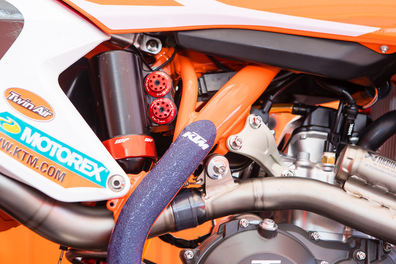 The new shock and mid-pipe mount that's on Tickle, Musquin, and Anderson's bikes this weekend has been seen in the GPs.