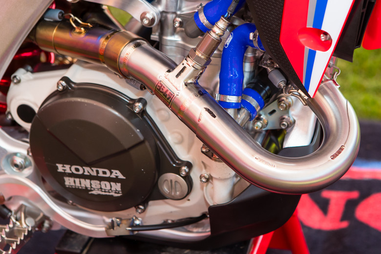 While the US team uses a longer header, without the chamber. Check out the extra protection sleeve on this polished header.