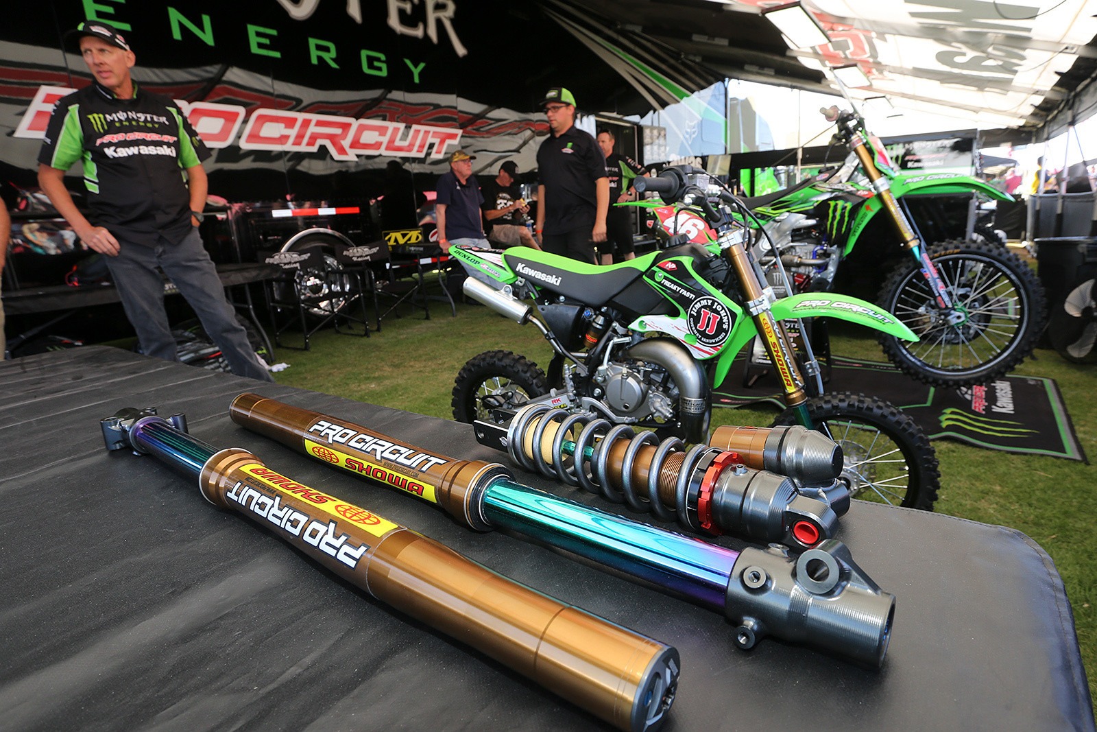 Showa A kit suspension for 65cc bikes? Yep, Bones was showing it off in the Monster Energy Pro Circuit Kawasaki tent.