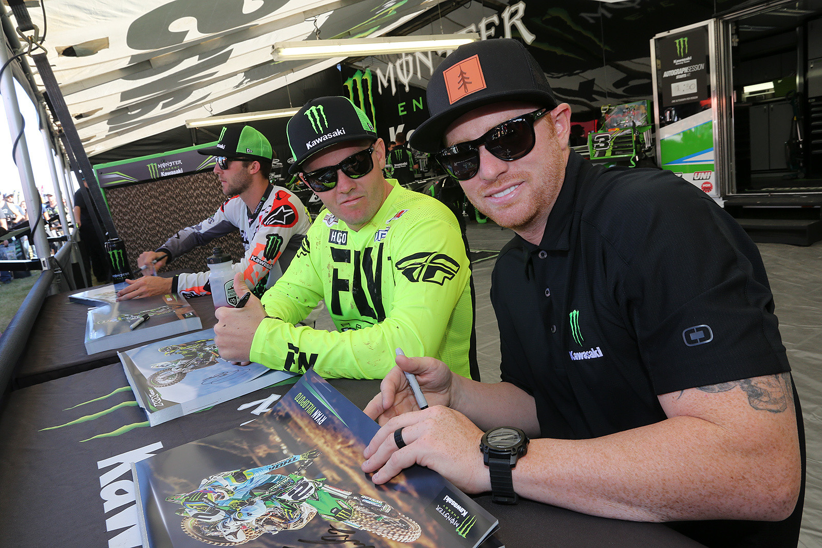 Eli Tomac, Josh Grant, and Ryan Villopoto getting arm pump signing autographs in the afternoon.