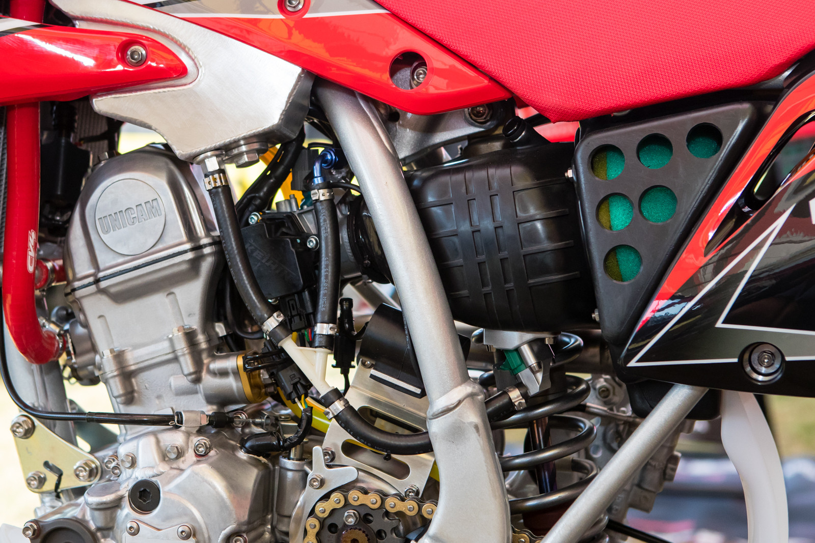 To of course work with the added fuel injection systems...which features duel fuel injectors and a throttle body from the CBR300 street bike.