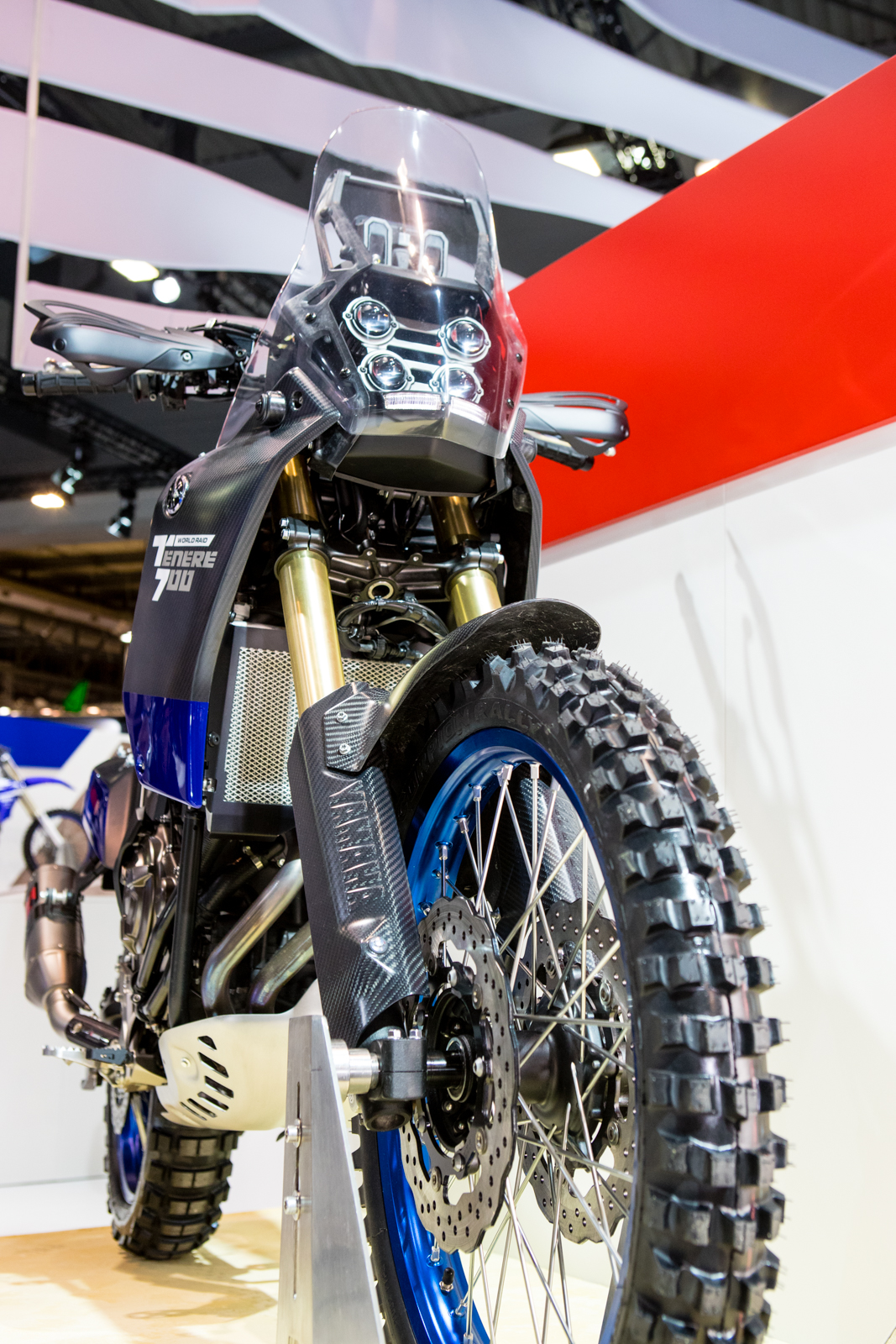 It has what looks to be a slightly shortened set of KYB forks, featuring dual brake rotors...albeit not too big, making it probably more manageable in the dirt.