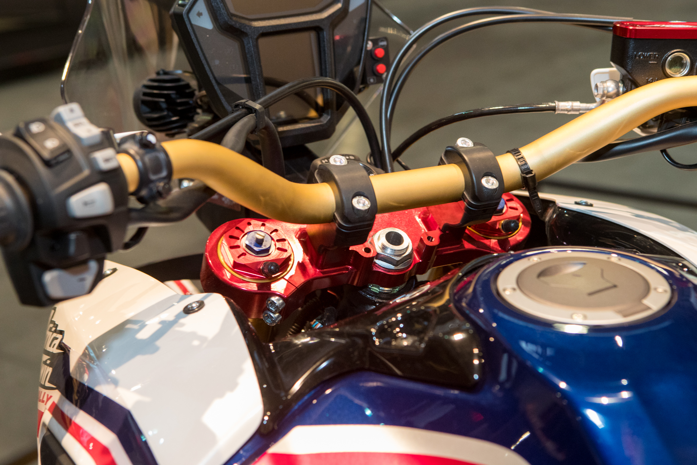 It also has beefier triple clamps, bar mounts, and new Showa forks that are more moto-esque and can have air added to the spring damping force.