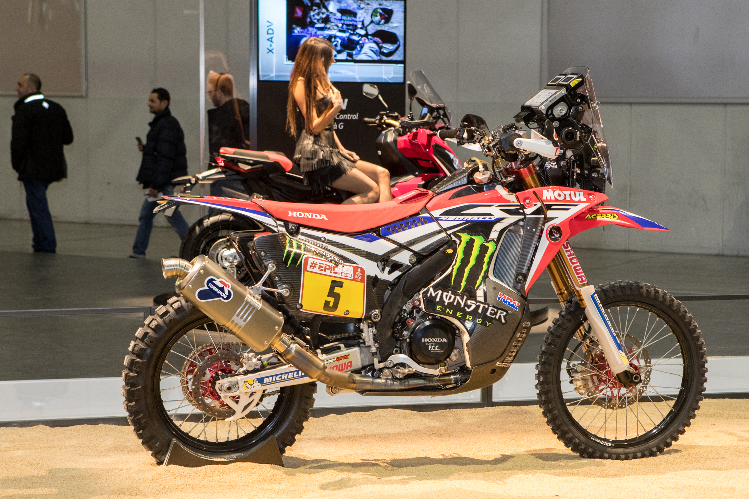 The latest CRF450R Rally shares very little with the motocross bike, maybe just a hand full of things such as forks, hubs, and a few bolts here and there. The engine is a one-off dual cam engine, it has its own frame and swingarm, bodywork, shock, electronics, and more.