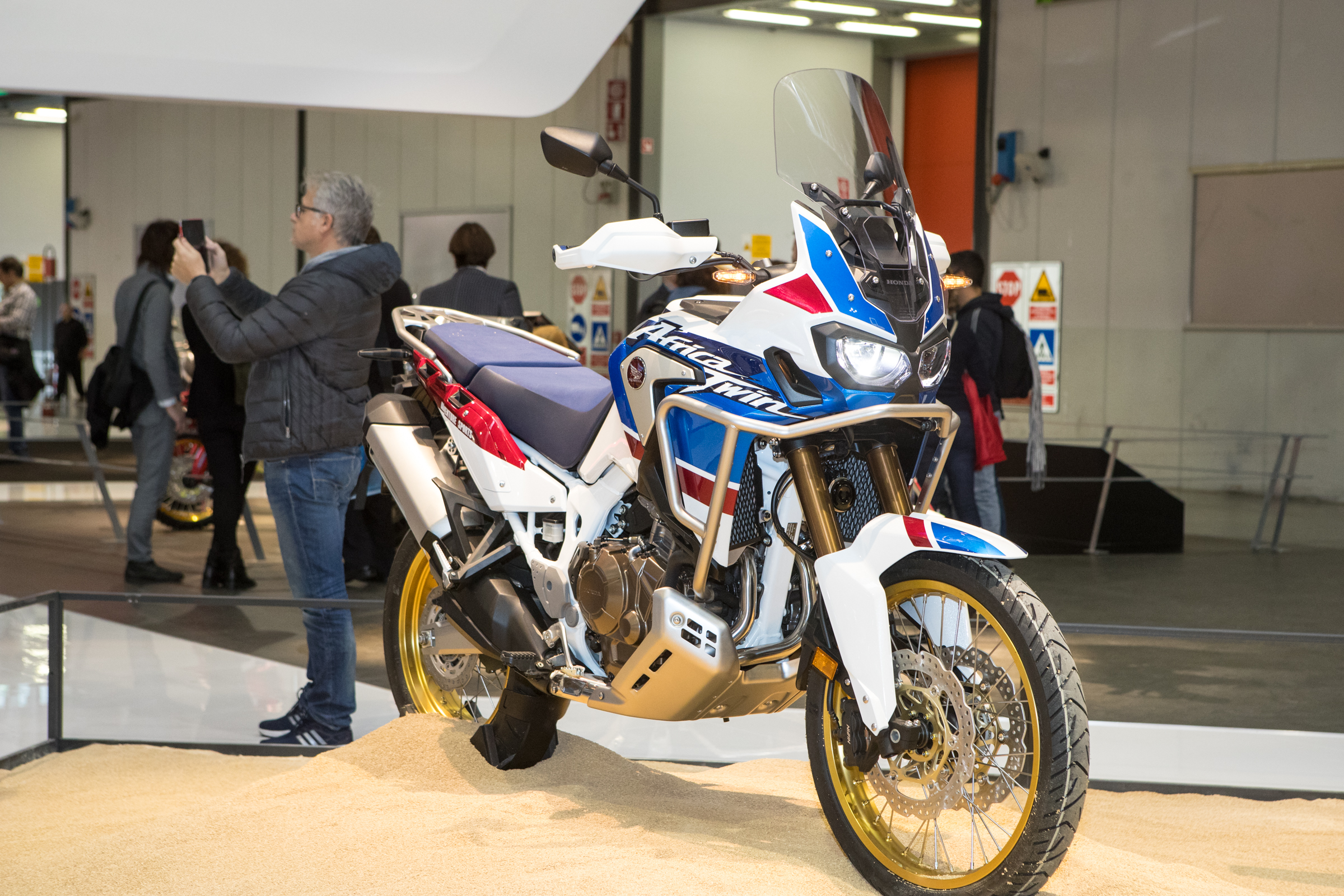 Honda released their newest Adventure model, the CRF1000L2 and the Sports model updates. The sports model features more guards, heated grips, a 1.6 gallon larger fuel tank, a longer travel rear shock, and more. While the standard L2 gets a slew of small updates throughout the bike.