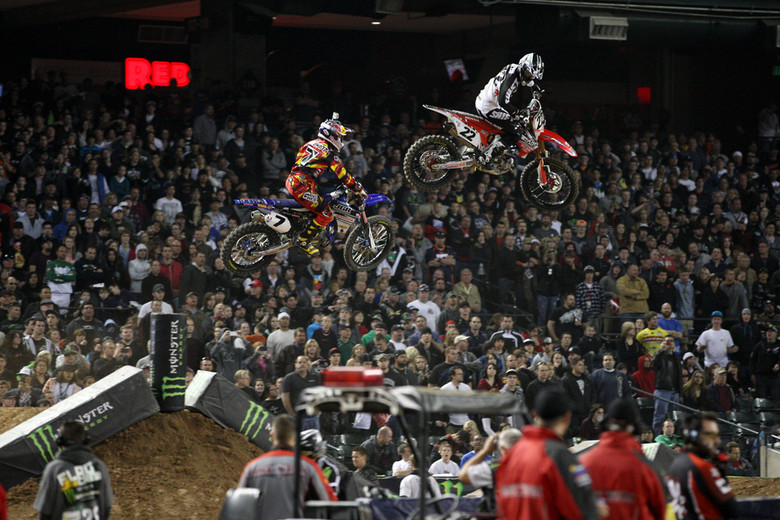 Chad Reed keeps an eye on James Stewart over one of the triples in Phoenix. Chad ended up in fifth, and Stewart eighth after a crash.