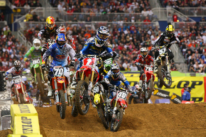 Justin Barcia grabbed the holeshot and lead every lap of the Supercross Lites main. Check the close contact between Blake Wharton and Justin Bogle.