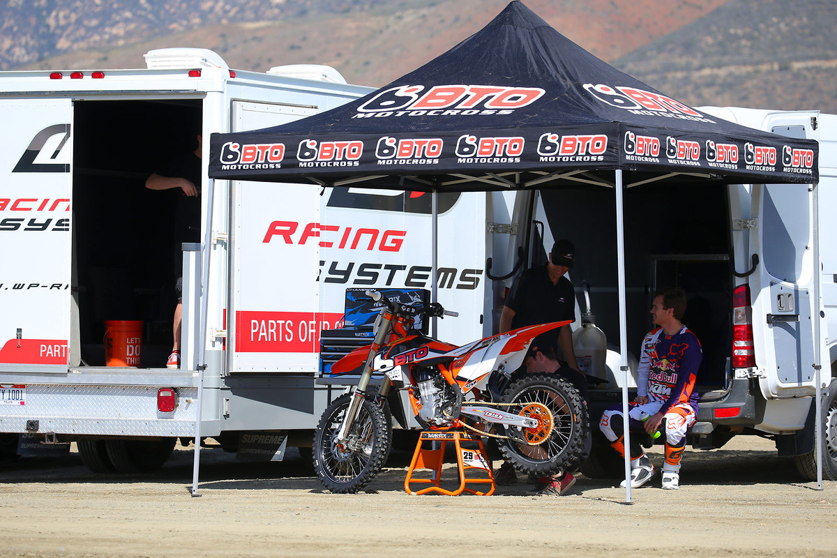 Part of Ryan Morais' duties at KTM are to help with setup for their various riders. He did a lot of the setup on Ryan Dungey's bike, toiling away last summer when no one would think to go out and check the KTM Supercross track. Today he was working on a setup for Andrew Short's Team BTO Sports/WPS KTM 450 Factory Edition. Ryan rode both the standard and WP air shock setups.
