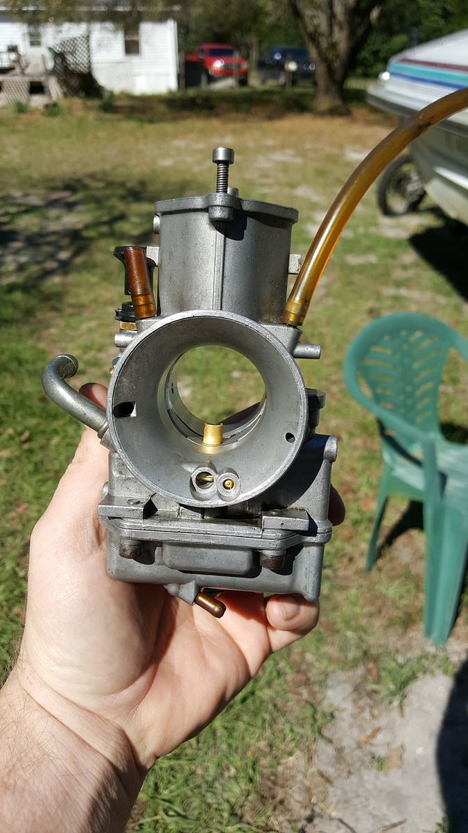 01 RM125 carb piston valve cracked carb swap?? - Tech Help