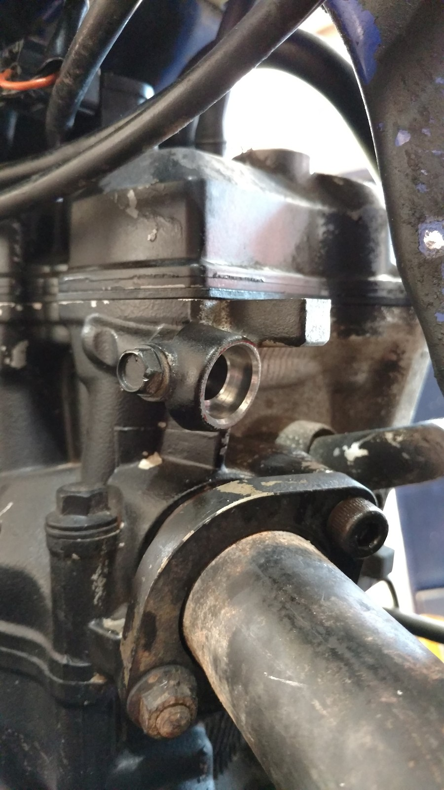 So while looking at my bike I noticed this little thing sticking out of the  engine, what is it?