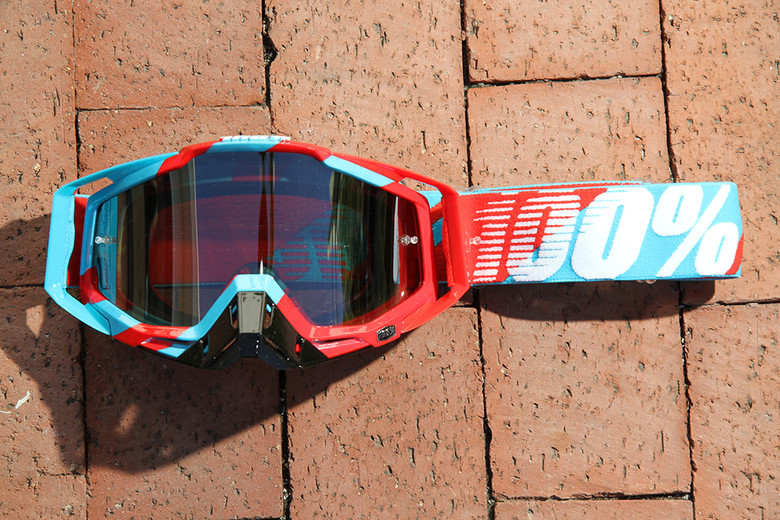 The Racecraft. 100%'s premium goggle with triple density foam, outriggers, removable nose guard. Shown in Supersonic.