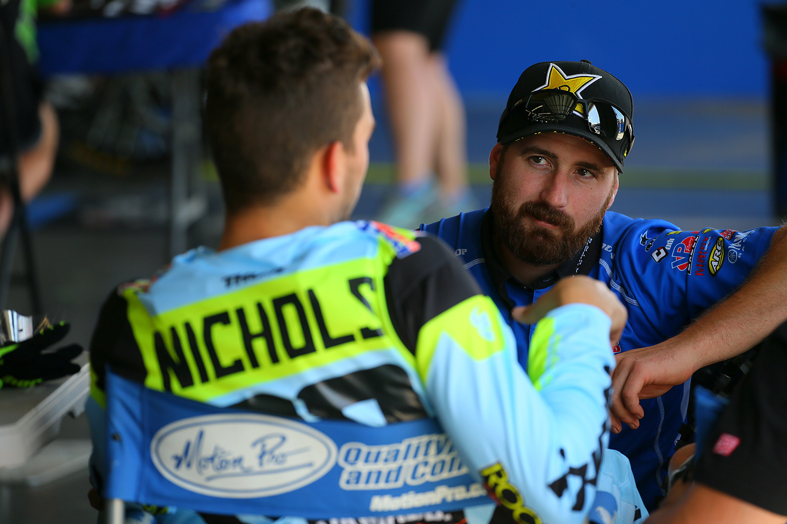 Colt Nichols' mechanic, Trevor Carmichael, checks in with him after the first untimed practice in Daytona.