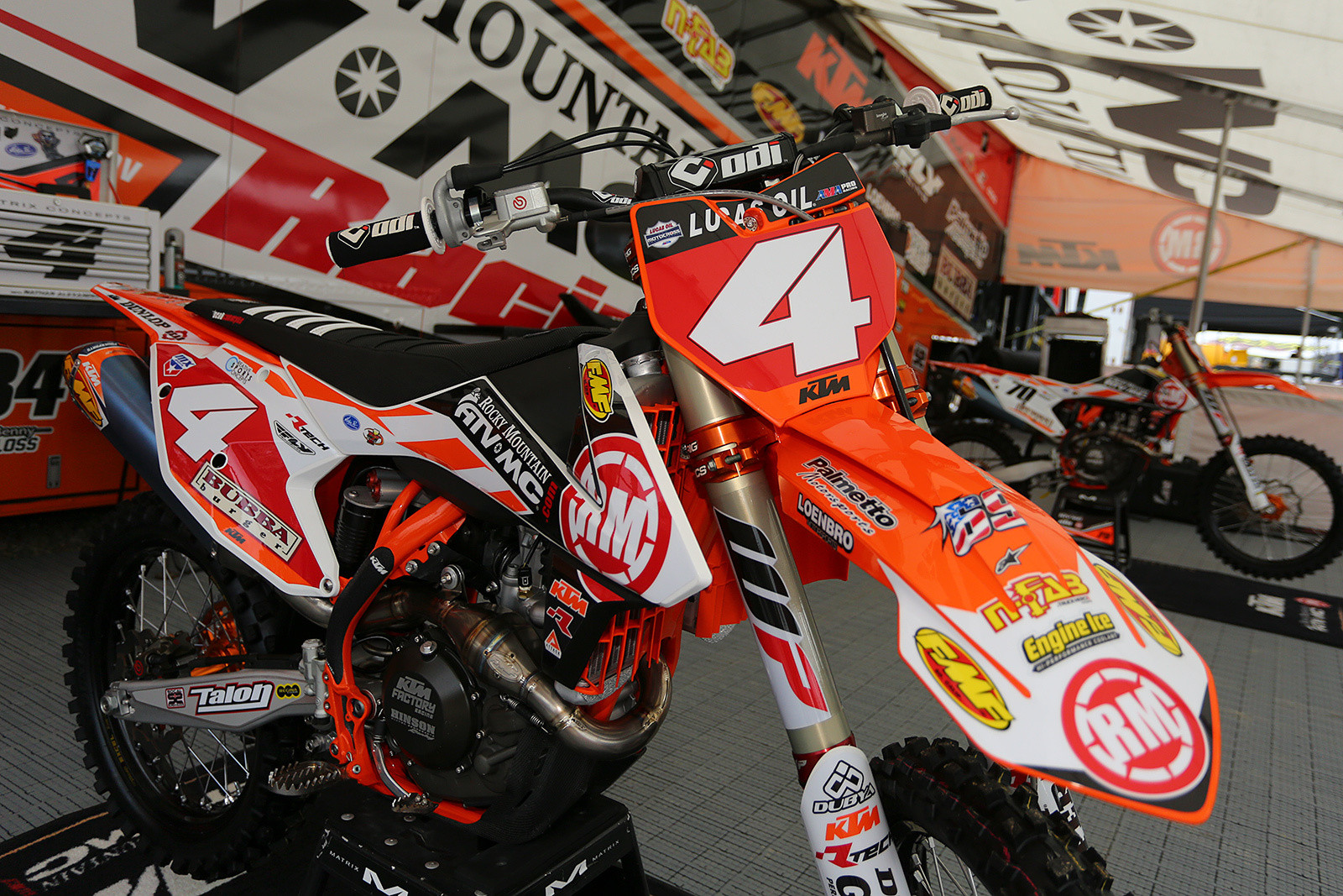 Blake Baggett's bike was looking pretty sharp with the red plates on it. They'll be on it for at least another week, as he was still on top after leaving Muddy Creek.