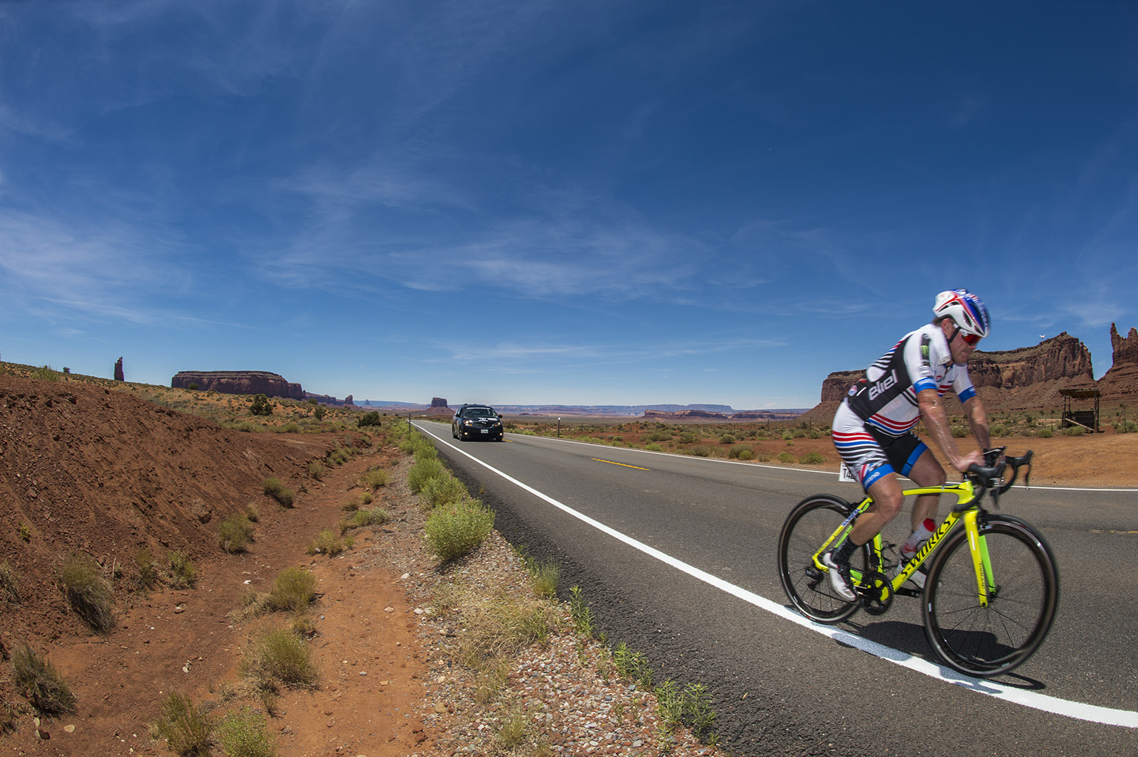 Jeff Ward spinning through the heat in Monument Valley.