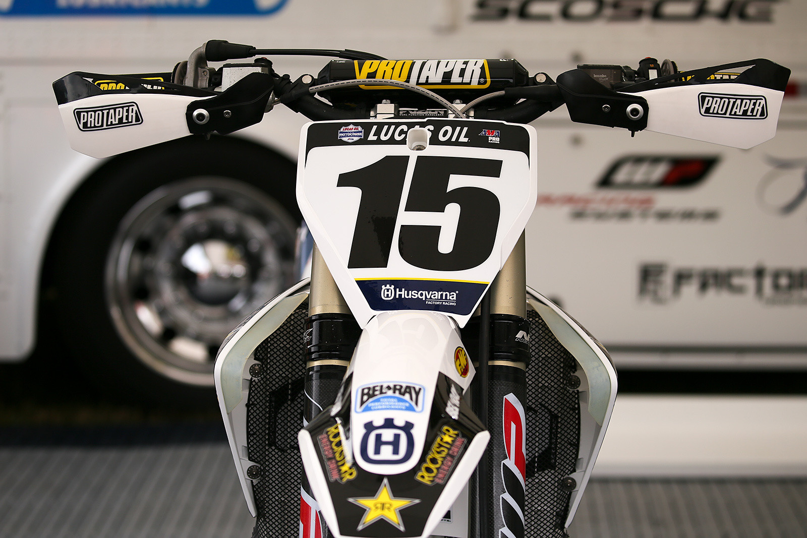 Dean Wilson's bike had simple add-ons to the handquards that he always runs. Also, note the lips added to the radiator shrouds on his bike, to prevent the long-legged Scot from hooking his boots on them. They've experimented with carbon and aluminum versions. The current ones are manufactured on a 3D printer.