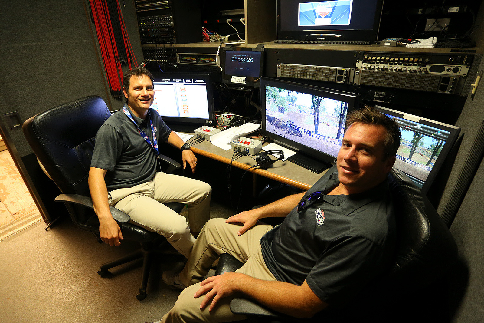 The announcing crew of Jason Weigant and Grant Langston are in a separate trailer from the director and producer, and have monitors for timing and scoring, the live view being shown to viewers, a preview screen for upcoming replays, and a telestrator (behind Grant). There's also a countdown clock so they know how long before the show starts, and to count in from breaks.