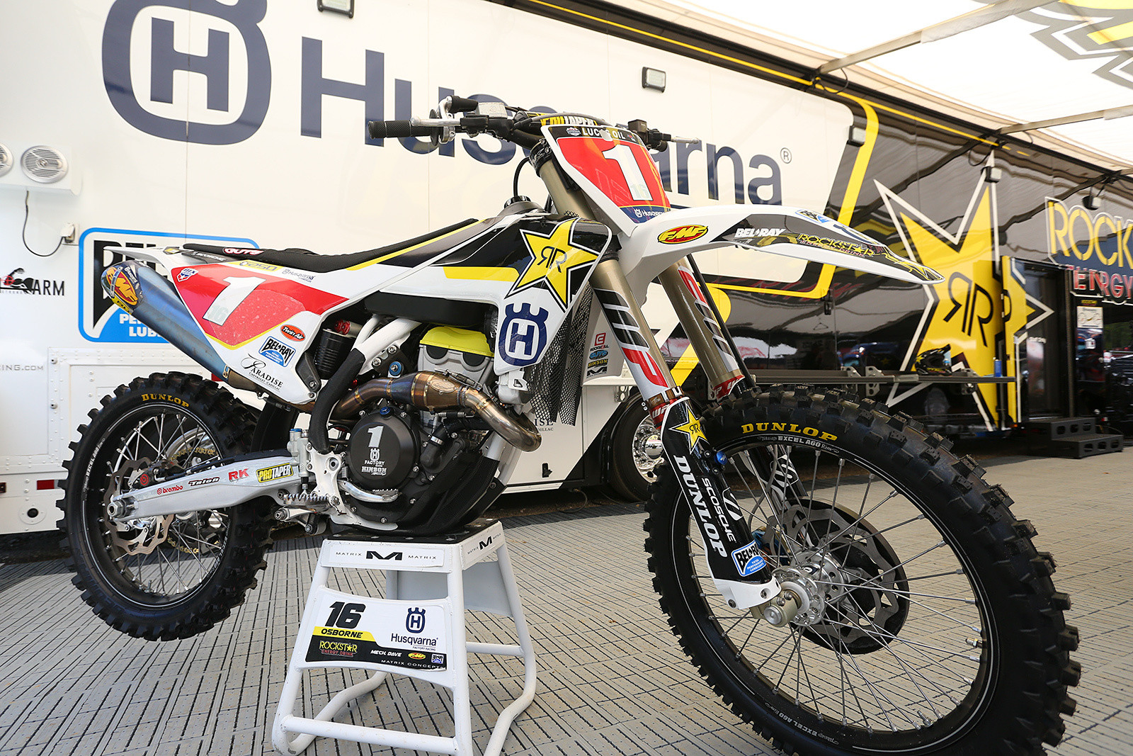 After wrapping up the 250 championship at Budds Creek, the Rockstar Energy Racing Husqvarna team showed up for press day at Ironman Raceway with a set of number one plates for Zach Osborne's bike. While he couldn't technically ride with them during Saturday's racing (Cooper Webb still was the defending champion until after the season ended, even though he's now in the 450 class), it was cool to see him be able to rock them during the one-off session. We'll see him defend his SX title with a 1E plate, and he'll be using whatever his permanent number is when he moves up to the 450 class next summer.