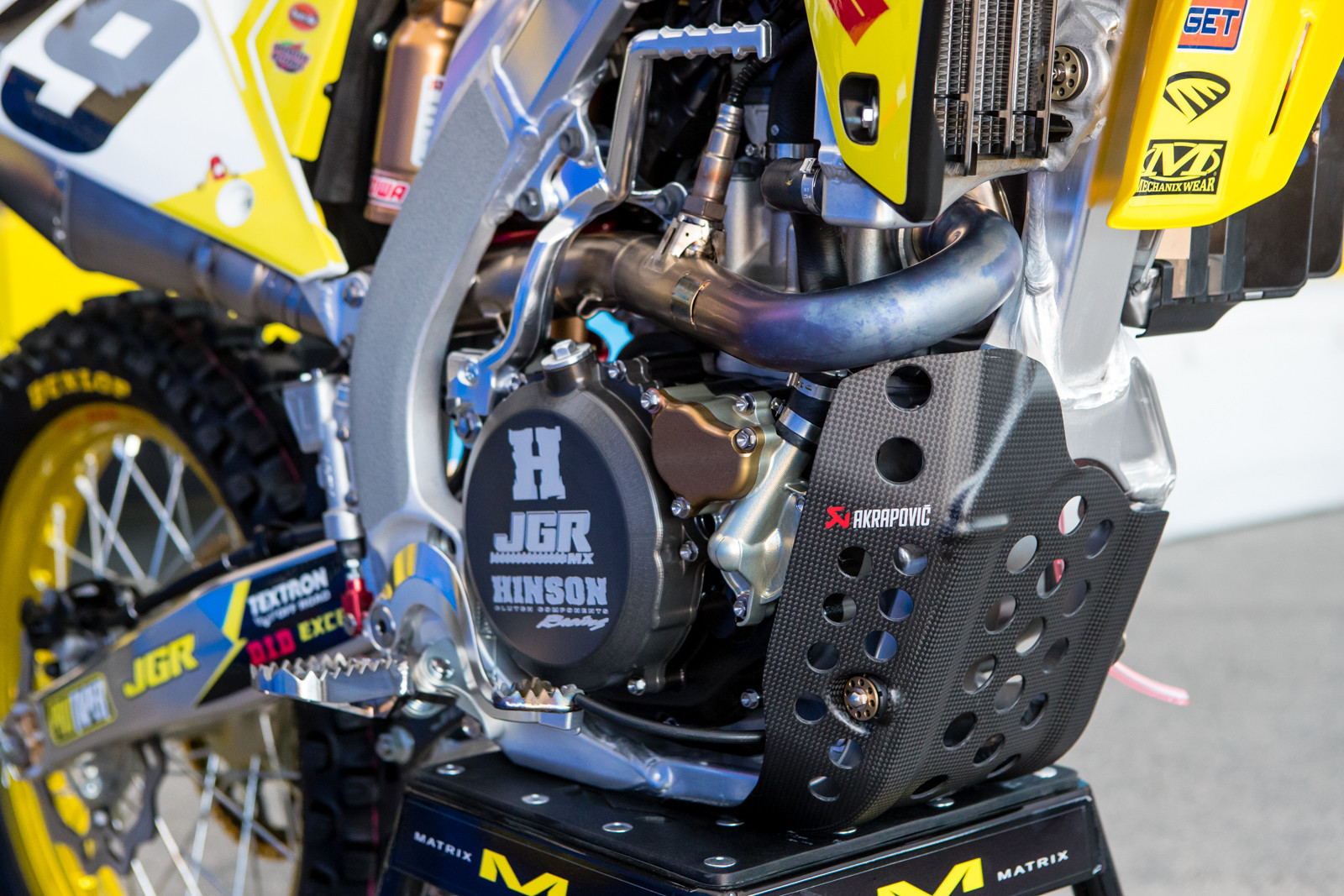 Although they don't use their exhausts, factory Suzuki and now JGR uses quite a few carbon components from Akrapovic.