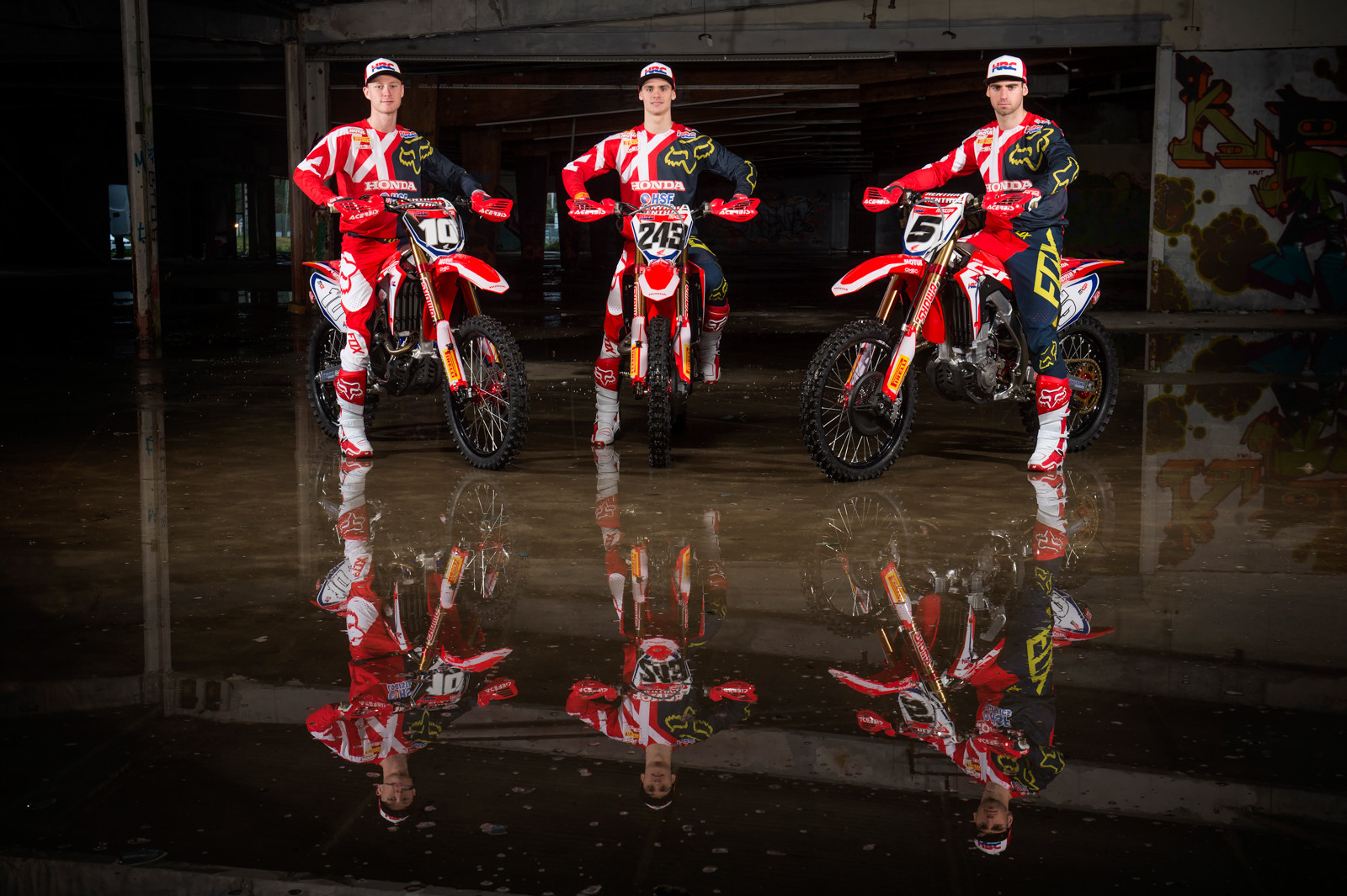 HRC's MX2 rider Calvin Vlaanderen on the left, center is prior MXGP champion Tim Gajser, and to his right is the team's other 450 rider Brian Bogers.