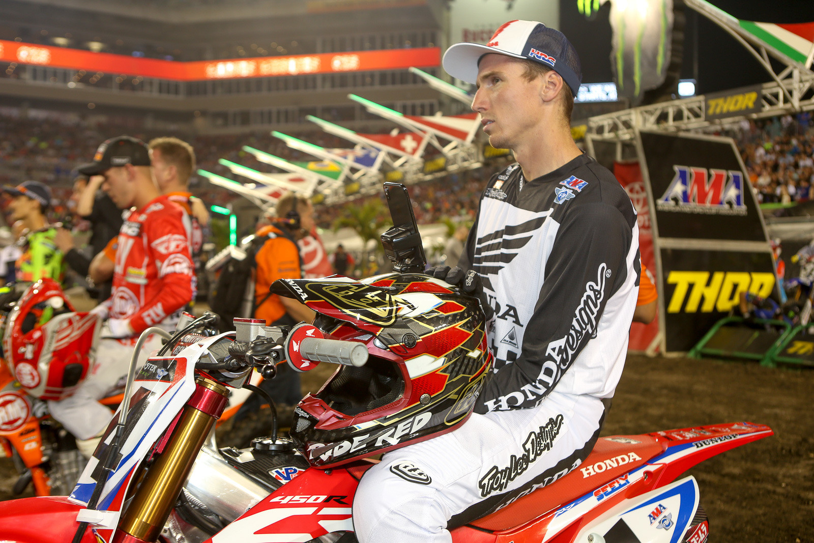 The last few weeks have been brutal on the 450 competitors. Weimer, Barcia, Roczen, Grant, Ray, were among the guys hurt before Tampa, and there we added Cole Seely to the list. His pelvis and tailbone injuries have already resulted in a surgery, and there's no doubt he'll be out for a while. He was doing some livestreaming (see the phone on his helmet) before the start of the night's action. What's the solution for making things safer? That's the million dollar question. Everyone knows this is dangerous. The fact that this is inherently dangerous is usually the first thing that's mentioned at the start of every rider's meeting. You may not hear it from everyone, but in conversations around the pits some folks suggest that 450s are too powerful for the stadiums. Others will mention track design. Some say the every weekend schedule doesn't help. One thing you can rest assured on is that everyone (including the promoters) would love to find a way to keep the riders healthy.