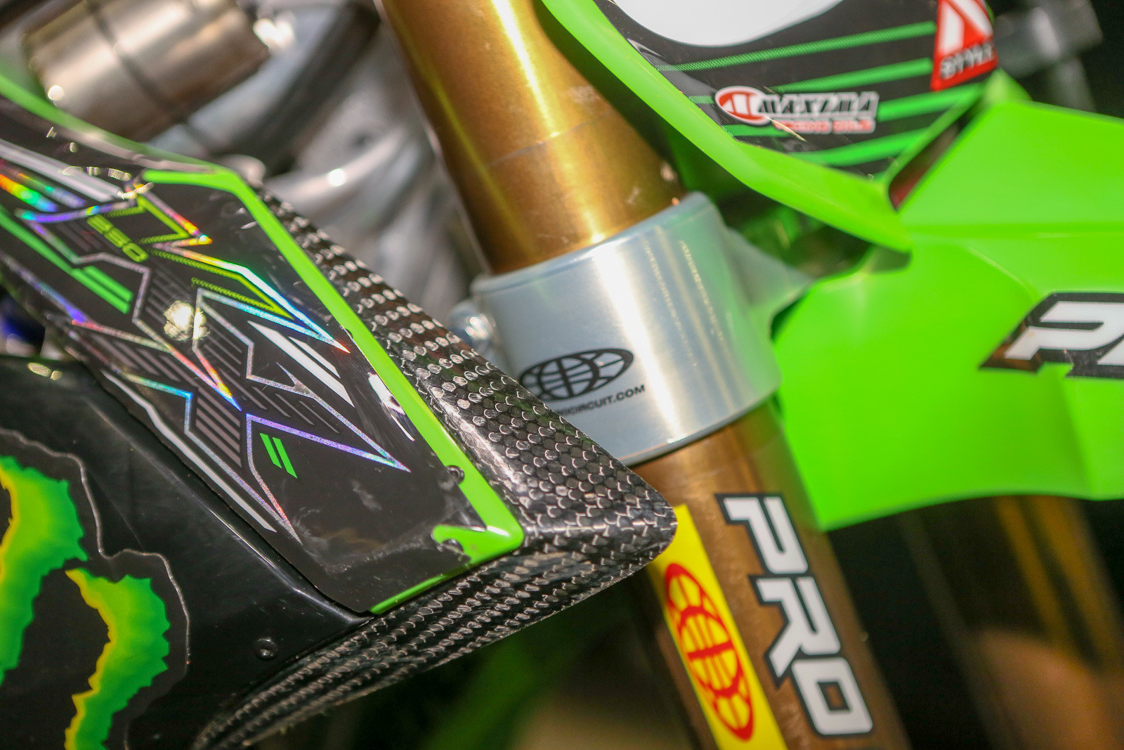 Remember last summer when Austin Forkner ripped his shrouds off a couple times? So does the Monster Energy Pro Circuit Kawasaki staff, so they added these extensions to the shroud to prevent it from happening again.