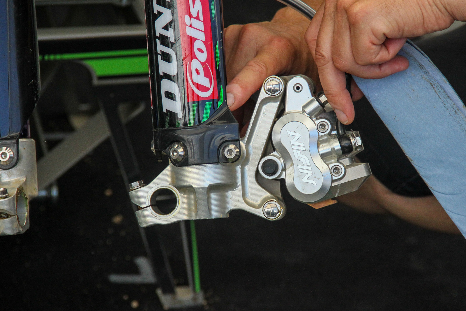 KRT in MXGP uses the Magnesium Nissin brake claiper like the US team, although the coatings are stripped off. So it's a bit more low-key to spot.