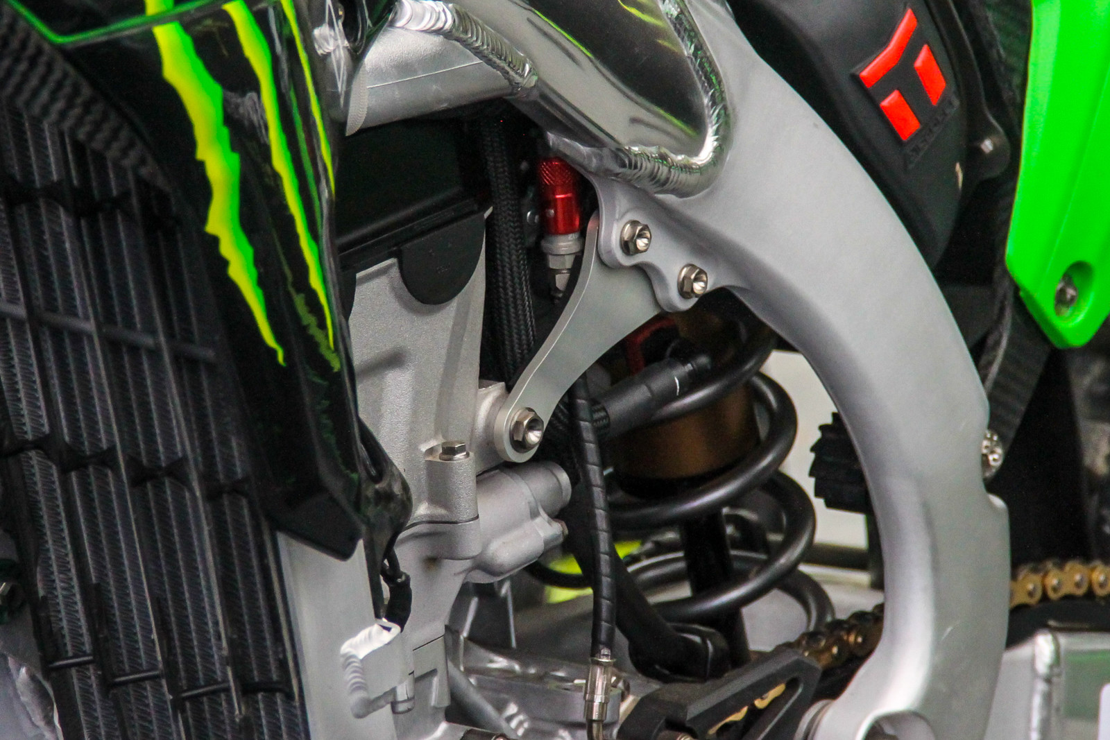 While the engine mount may look stock, it's not. Different materials and thicknesses are found on the KRT KX450F-SRs.