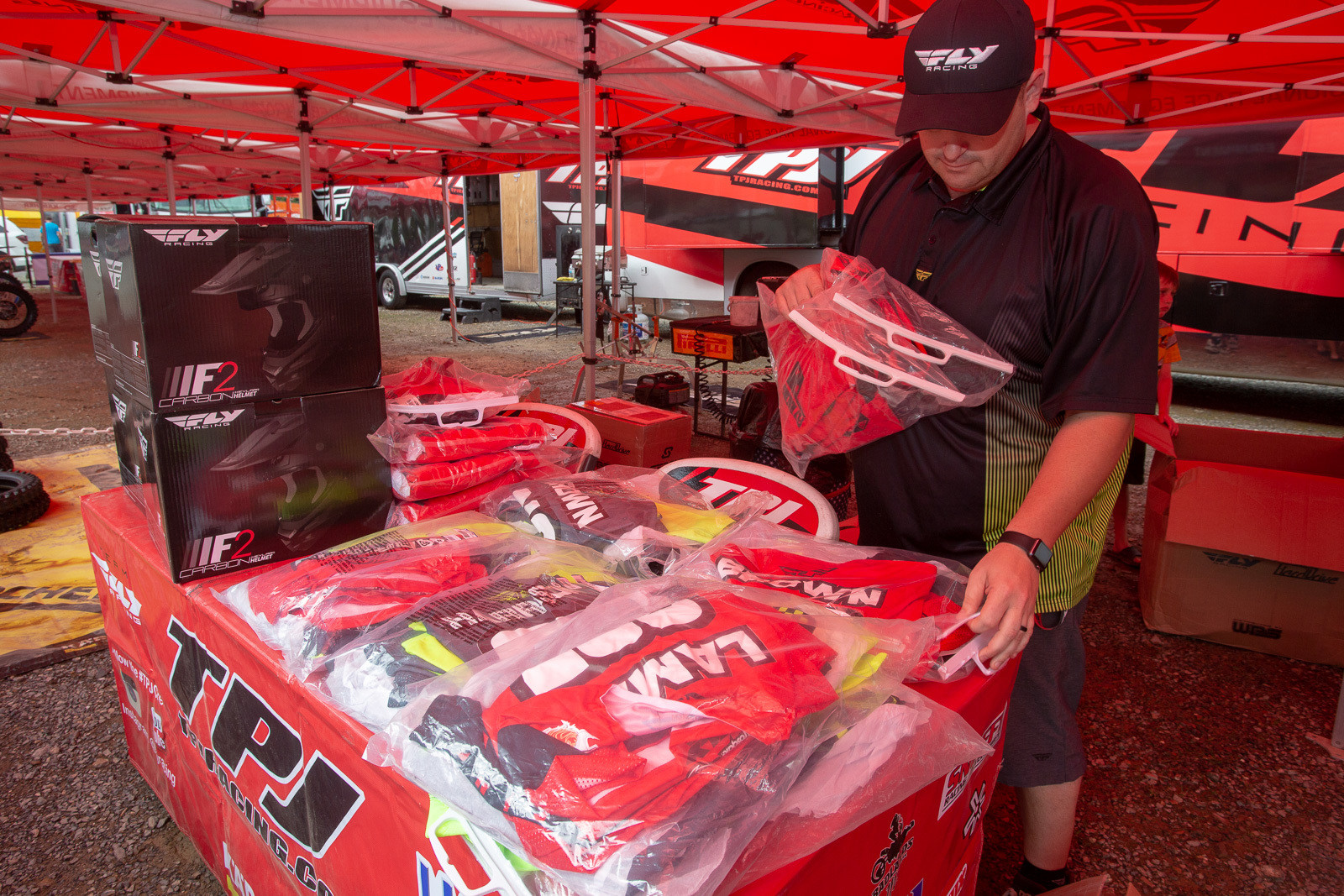 Fly's Max Steffans doing his gear sorting and delivery on Friday morning. What you see here is the gear for the Phoenix Racing guys. There were several other tables full of other gear, and it's pretty amazing the amount of product they dispense every weekend to their sponsored riders.