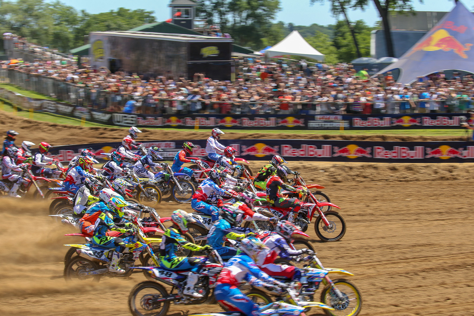 Big crowds, big excitement, and a big celebration are always part of the plan at RedBud. Three foreign riders, Toshiki Tomita, Marvin Musquin, and Jake Nicholls, helped get the party started by leading the way down the start straight in moto two.