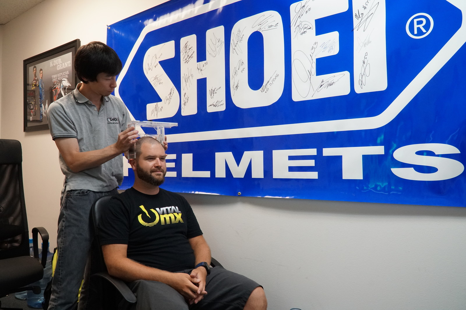 Mr. Moichi Tsuzuki, President of SHOEI North America, uses the measuring device to get width, height, and length of my head.