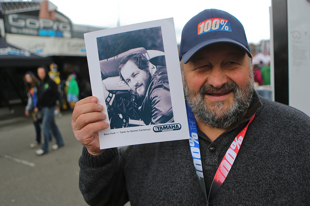Bevo with a photo from his early days, when he was a Team Yamaha wrench for Donnie Cantaloupi.