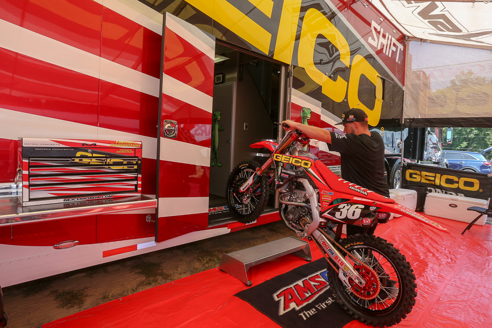 Keith Clickstein unloading RJ Hampshire's race-winning 250 out of the GEICO Honda rig on Friday morning.