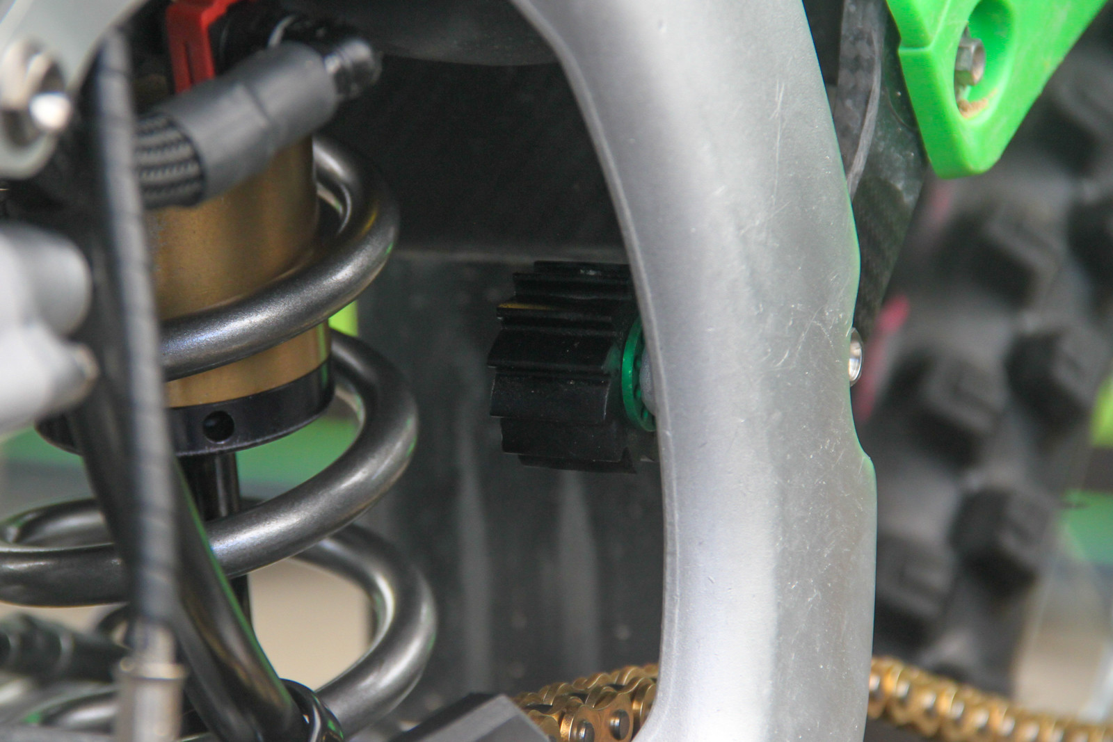 Spy the drilled out washer behind the chain roller on the KRt KX450F-SR. It's the little things...