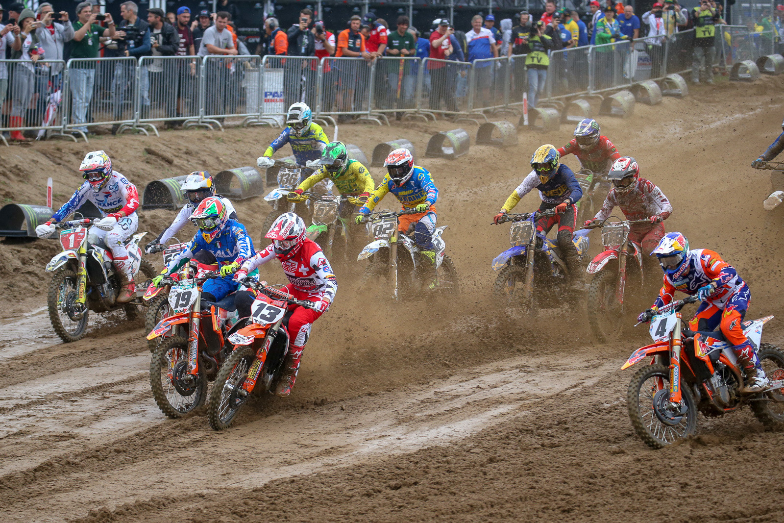 Coming into the first turn, Valentin Guillod (13) had to take evasive action to avoid collecting Antonio Cairoli (19). That may have spooked Jeffrey Herlings (4), who lost the front end and went down hard right after this.