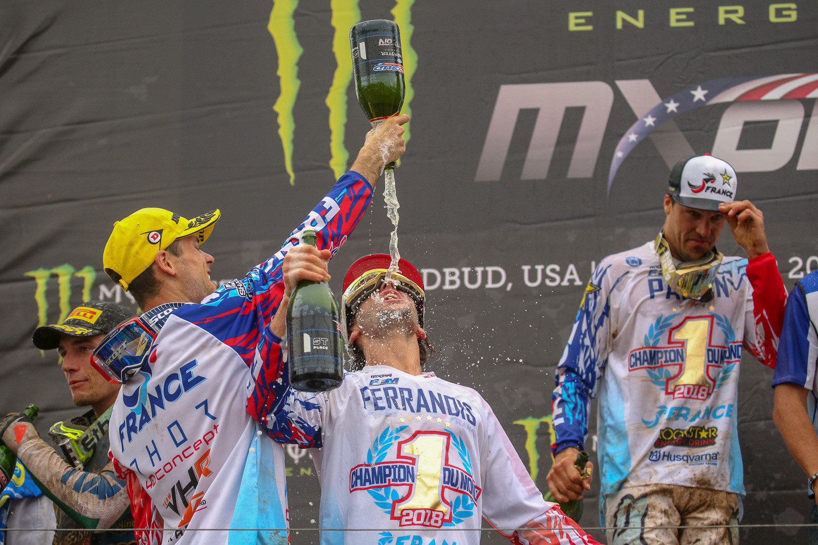 Jordi Tixier helps out Dylan Ferrandis with some champagne...