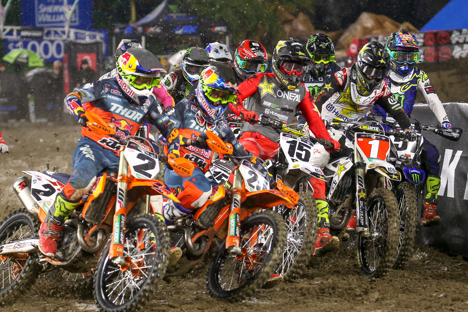 Dean Wilson (15) broke out from the pack and jumped into the lead after the first turn in the 450 main event.