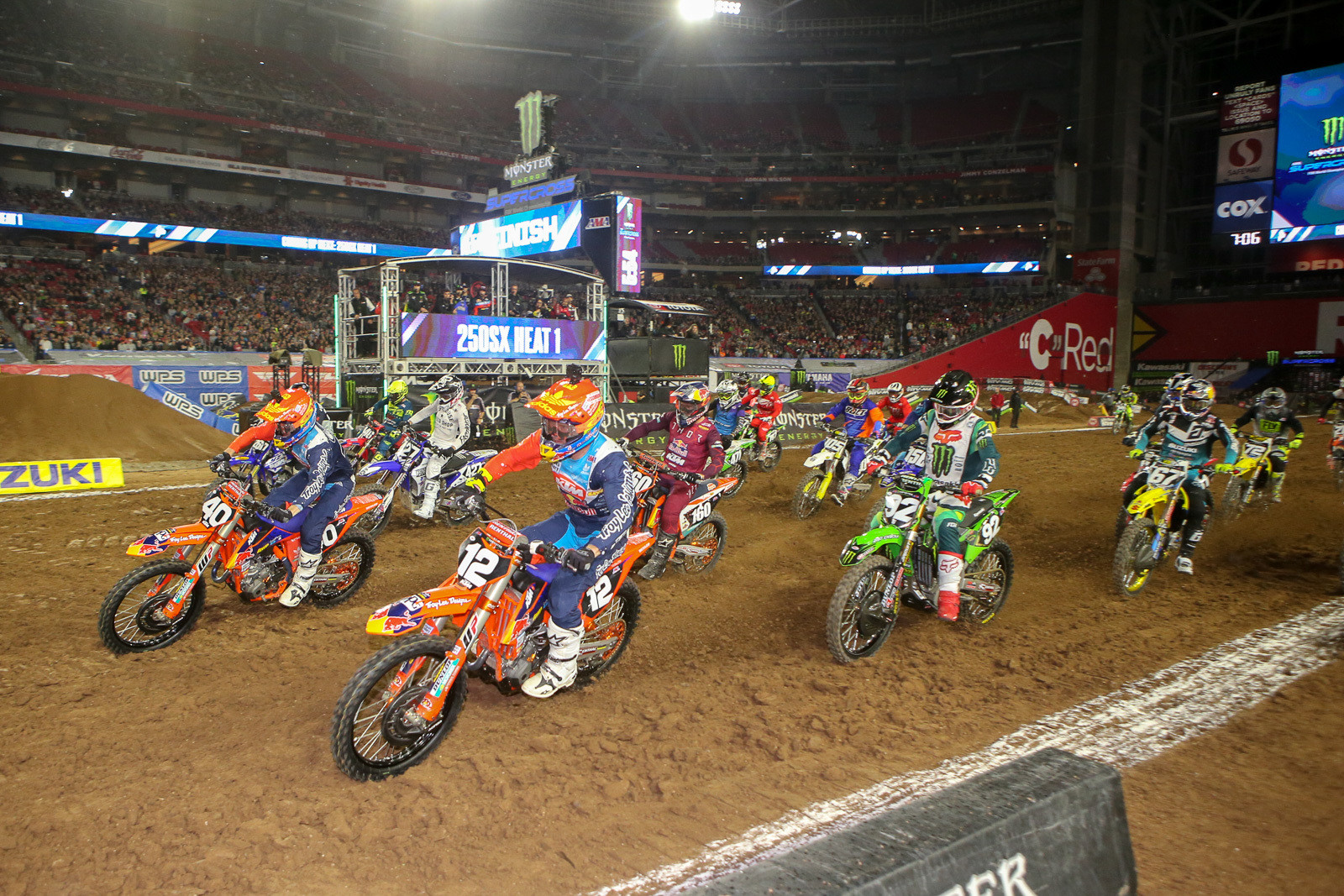 It was all Troy Lee Designs/Red Bull/KTM with Sean Cantrell and Shane McElrath up front as the riders got to the first turn at the end of the long start straight to start the night in 250 heat one. Adam Cianciarulo (92) came through to take the win in this one.