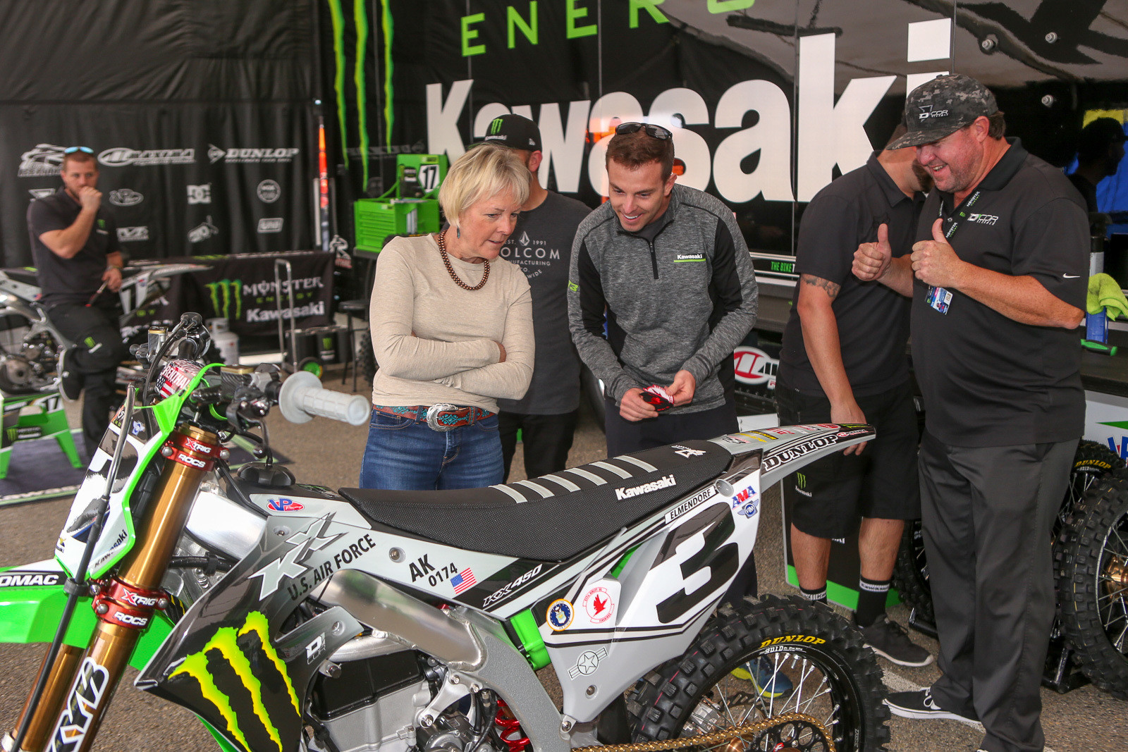 Of course, San Diego is the annual military appreciation race, and the teams had some cool bits this time around. Each of the Monster Energy Kawasaki bikes featured a different story. Eli Tomac's bike had his brother Greg's Air Force base, air wing insignia, and tail number info on it. Here, Greg checks out the bike, while his mom, Kathy, and D'Cor's Danny Dobey look on.